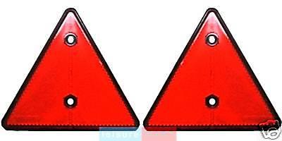 A pair of trailer caravan triangle reflectors red