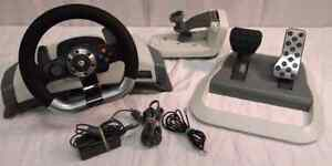Steering wheel with pedal and 2 games  London Ontario image 1