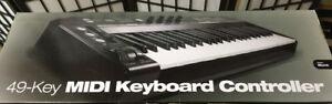49-Key MIDI Keyboard Controller.