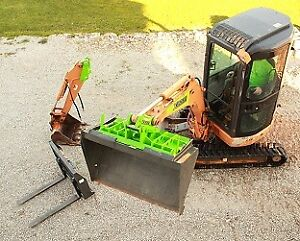 Mini Excavator XBoom Coupler for using Skidsteer Attachments