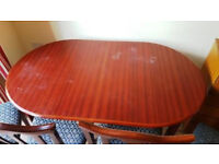 Free. Extending dining table and four chairs