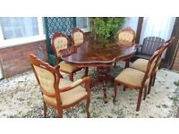 Rococo style marquetry dining table with six chairs; gold upholstery