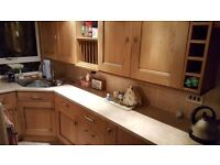 Kitchen Cabinets and Appliances. Solid oak doors and top range appliances.
