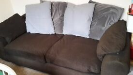 Large Dark Brown Fabric Sofa with Grey Backing Cushions. Good Condition. Can Deliver