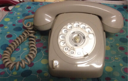 Old Telecom Dial Phone with RARE key Lock Key