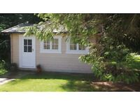 Beauty Room - large log cabin in relaxing country location with parking