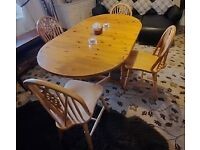 Solid pine table complete with 4 matching chairs good condition