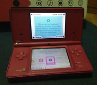 Pink Nintendo DSi with some games