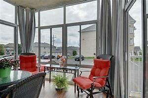 magnifique condo à vendre 1 ' plancher avec solarium,garage