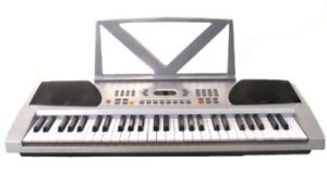 CLAVIER ELECTRONIC  54 KEYS MUSICAL PIANO AVEC MICROPHONE BANDST