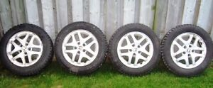 REDUCED - 4 NEAR NEW MOUNTED SNOW TIRES