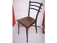 A rare Thonet bentwood chair with original faux tooled leather seat. Made in Austria.
