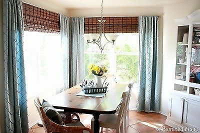 Consider layering window treatments to achieve a layered visual texture. (Image: Remodelaholic)