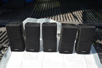 Five Bose Surround Sound Speakers and a Panasonic Subwoofer