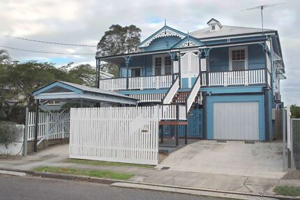A large bedroom with study in spacious inner City Queenslander