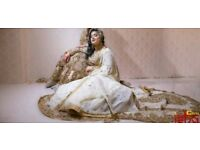 White and gold Indian wedding bridal dress