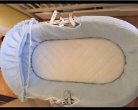 White wicker Moses basket with blue detail