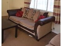 2x 3 seater tan brown sofas from DFS - from a pet free and smoke free home