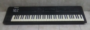 Ensoniq SQ2 synthesizer with wheeled carrying case