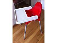 Red ikea plastic highchair