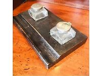 A pair of monogrammed inkwells with silver tops on an ebonised base with pen holder just lovely