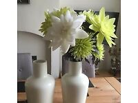 Total of 8 cream vases available with decorative flowers