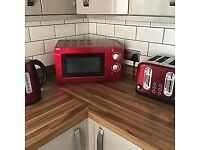 Red Kitchen microwave, kettle and toaster