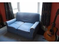 2-seater sofa – sound and comfortable (with cushions), but cover needs attention.