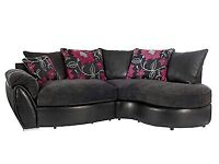 Black curved sofa with double sided cushions
