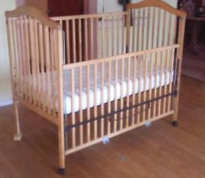 adjustable high quality crib and mattress.