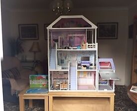 large dolls house and furniture standsd about 4feet high gardens and garage at side