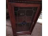 cupboard with stained glass door