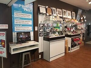 Photography, finishing, printing, cameras and supply Store