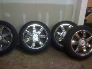 "Wanted Cadillac 22"" 7 spoke Rims and Tires"