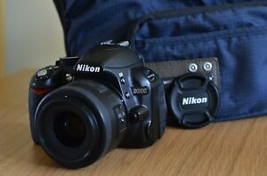 Nikon d3100 with 35mm f1.8 lens and SD card