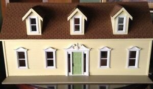 Wooden dollhouse bungalow