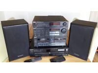 Technics Stereo System and a Sony 5 Platter Compact Disk player