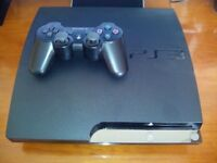 PS3 SLIM WITH 160 GB HARD DRIVE, WIRELESS CONTROLLER AND 2 GAMES