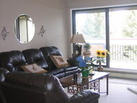 Spacious 3 bdrm condo in SW with large deck in great location!