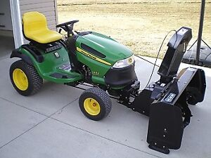 ALMOST NEW JD WITH  NEW BLOWER