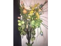 Tall metal artificial flower stand with flowers