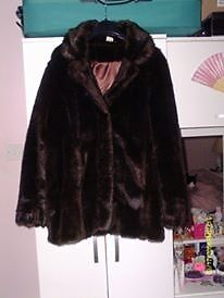 A ladies fake fur brown jacket, size 20.