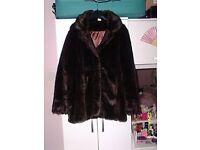 A ladies brown fake fur jacket.