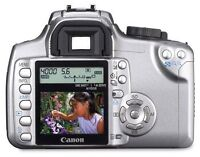 Canon XT SLR Body with grip, charger & 2 batteries.