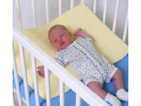 Infant and Toddler Safety Wedge Pillow for Cot. Brand new, never used.