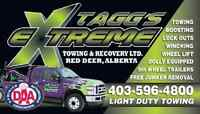 HAVING VEHICLE PROBLEMS? CALL TAGG'S EXTREME TOWING