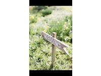 Wooden arrow wedding and reception signs