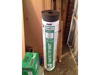 Roll of green mineral shed felt heavy duty