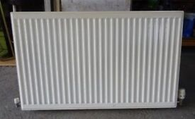 Central heating radiator - H 60 x W 100 x D 11 cms with thermostat - £25.00 ono