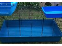 One inside cage, excellent condition, 100cms long, red base, with house, bottle, bowl, hayrack